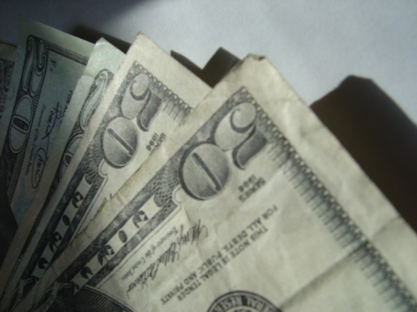 money photo of several fifty dollar bills