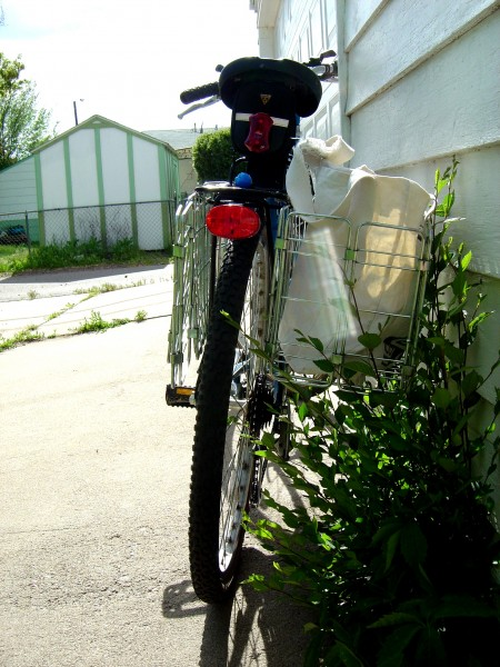 photo of bicycle from rear with baskets