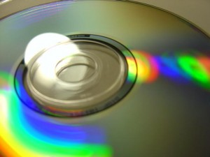 close up photo of audio CD with rainbow reflecting colors