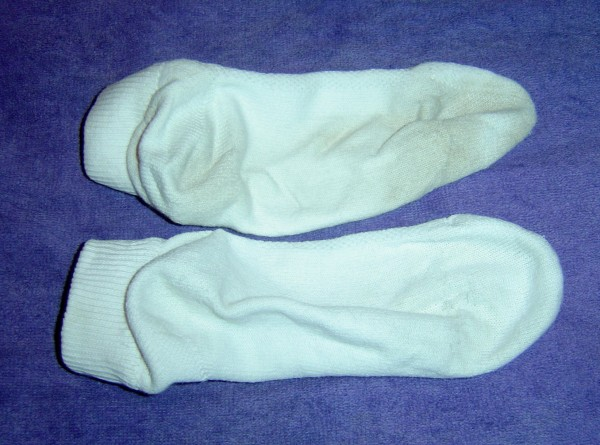 photo of one clean sock and one dirty sock comparison