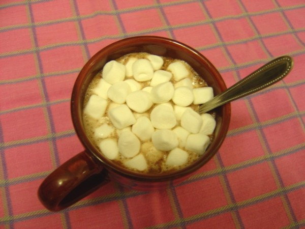 mug full of hot chocolate with mini marshmallows and spoon
