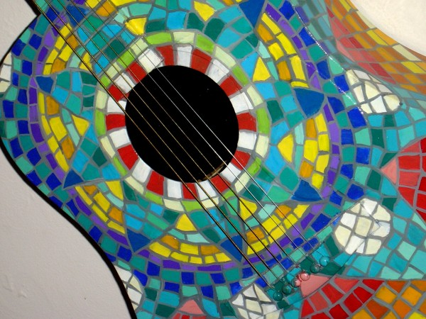 photo of guitar painted to look like colored Mexican tiles