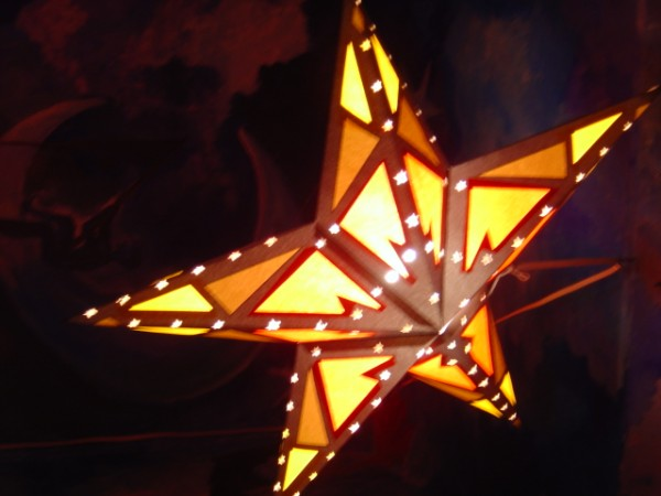 photo of a yellow and orange star shaped light
