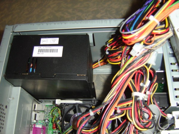 photo of computer with wires and power supply showing