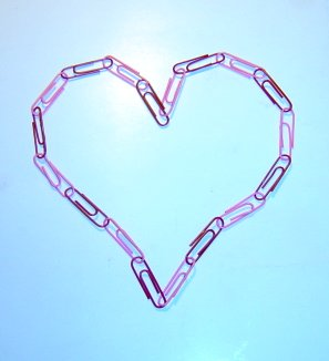 Photo of a heart made from a chain of pink and red paperclips