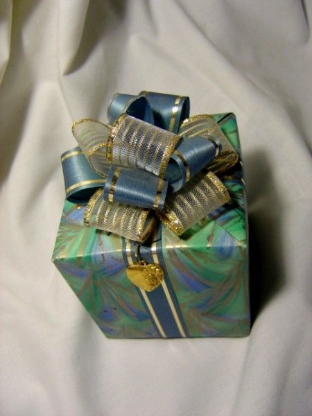 photo of wrapped package with a bow and a heart