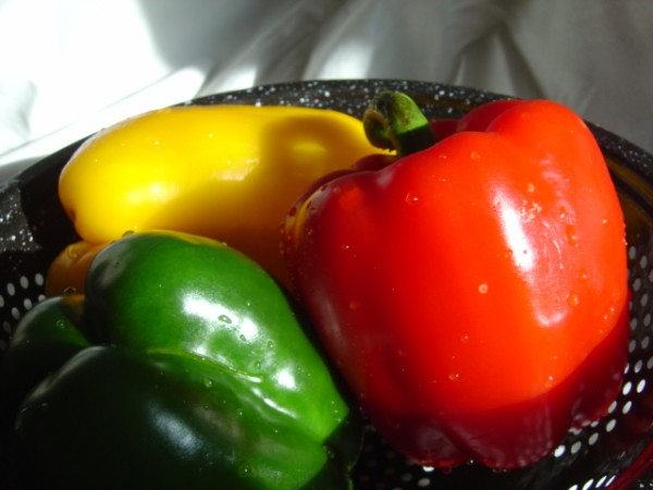 photo of three red yellow and green stoplight bell peppers