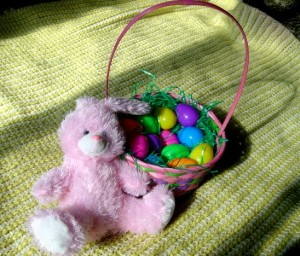 Photo of Pink Easter bunny with and Easter Basket full of colored eggs