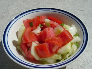 Photo of a bowl of tomato and cucumber salad