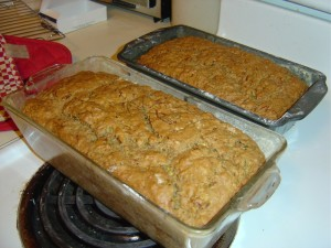 Two loaves of zucchini bread cooling on the stove top