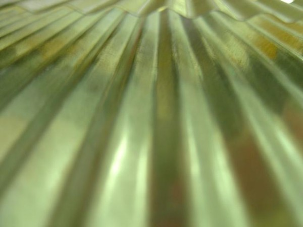 close up photo of a the grooves in a washboard