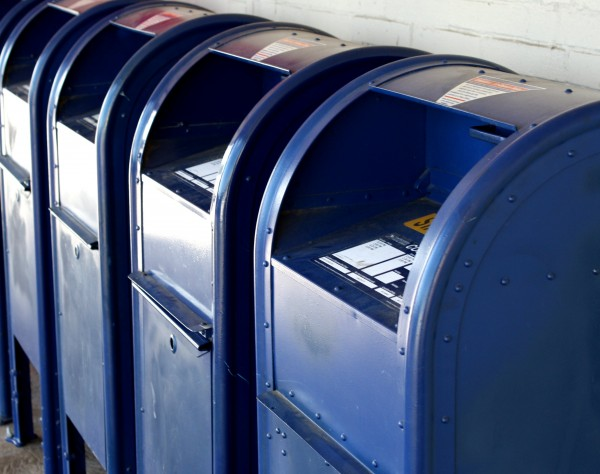 Free photo of a row of blue USPS mail boxes