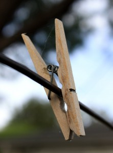 free photo of a wooden clothespin on a clothesline
