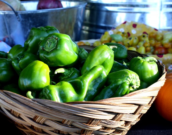 Free photo of a basket full of green peppers