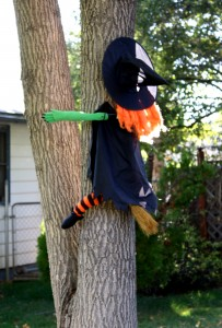 Free photo of a funny Halloween decoration of a witch flying into a tree