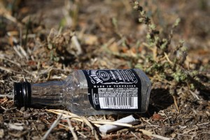 Free high resolution photo of an empty Jack Daniels Whisky bottle on the ground