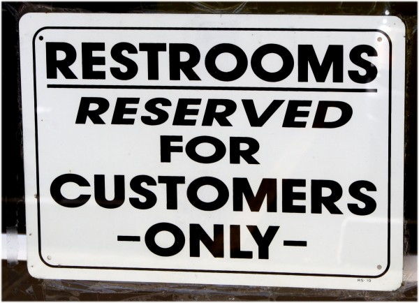 Free high resolution photo of a sign reading restrooms reserved for customers only