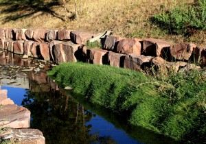 free high resolution photo of a stream with a rock retaining wall