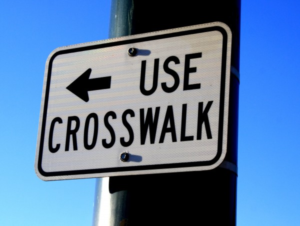 free photo of a sign reading: Use Crosswalk