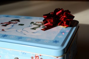 Red Bow atop Holiday Cookie Tin - free high resolution photo