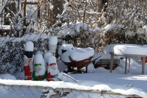 Snow Covered Christmas Figurines, Wheelbarrow, Table and Wagon - Free High Resolution Photo