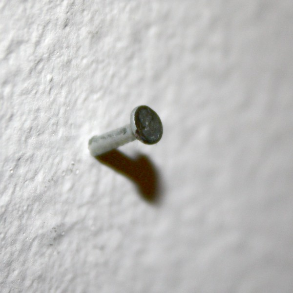 Small Nail Head Sticking out of Wall - Free High Resolution Photo