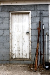 Old Shed Door with Metal Stakes Leaning Next to it - Free High Resolution Photo