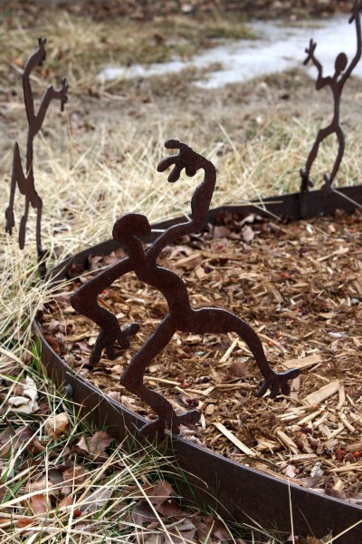 Welded Metal Tree Ring Sculpture with Dancing Men - Free High Resolution Photo