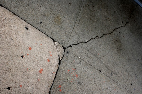 Cement Sidewalk with Cracks and Paint Splatters - Free High Resolution Photo