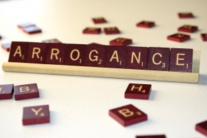 Arrogance - Free High Resolution Photo of the word Arrogance spelled in Scrabble tiles