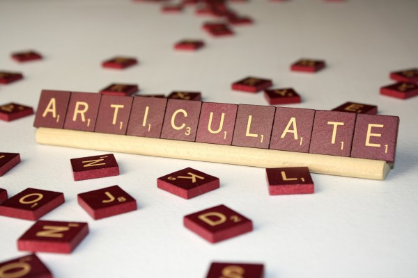 Articulate - Free High Resolution Photo of the word Articulate spelled in Scrabble tiles