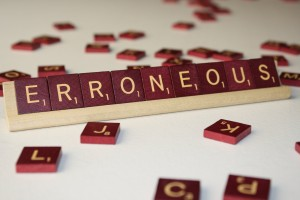 Erroneous - Free High Resolution Photo of the word erroneous spelled in Scrabble tiles