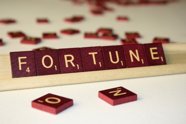 Fortune - Free High Resolution Photo of the word Fortune spelled in Scrabble tiles