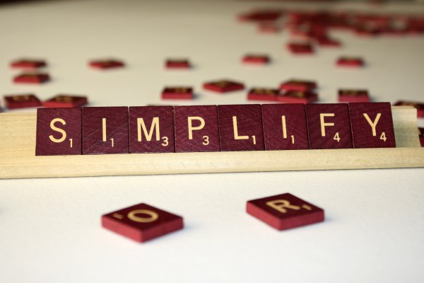 Simplify - Free High Resolution Photo of the word Simplify spelled in Scrabble tiles