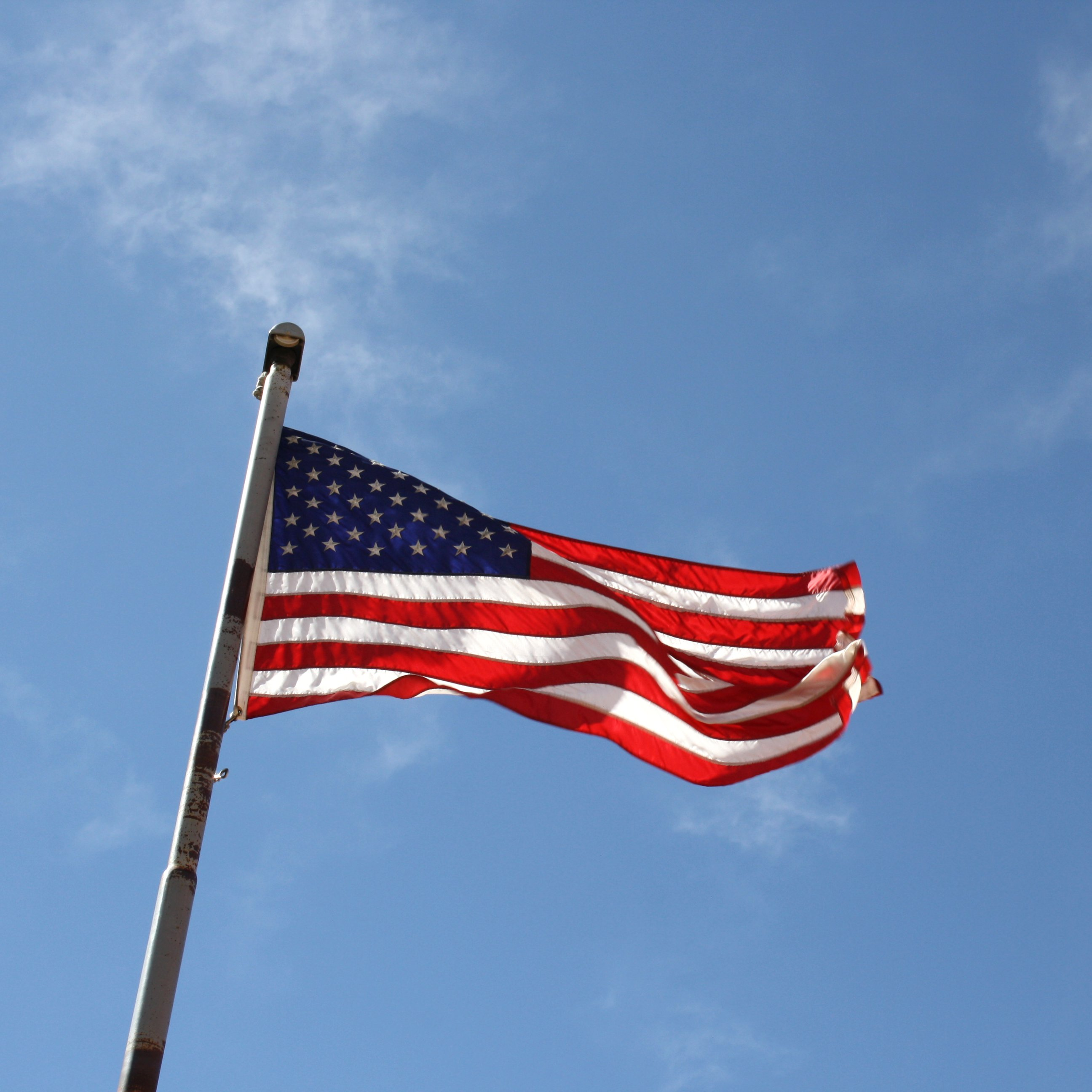 American Flag Atop Flagpole Picture Free Photograph