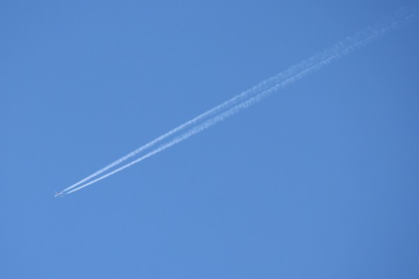 Airplane in Sky with Contrails - Free High Resolution Photo