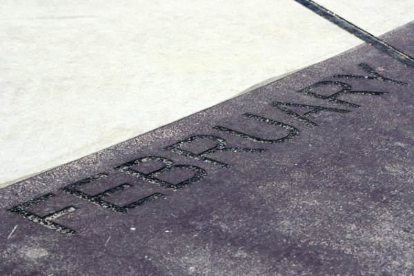 February - free high resolution photo of the word February - part of a sidewalk solar calendar