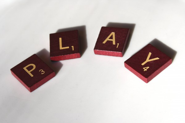 Play - free high resolution photo of Scrabble letter tiles spelling the word play