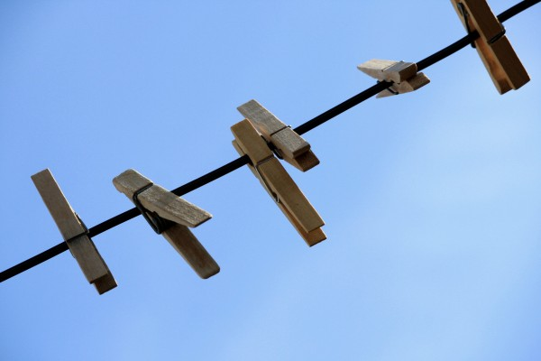 Wooden Clothespins on Clothes Line with Blue Sky in the Background - Free High Resolution Photo