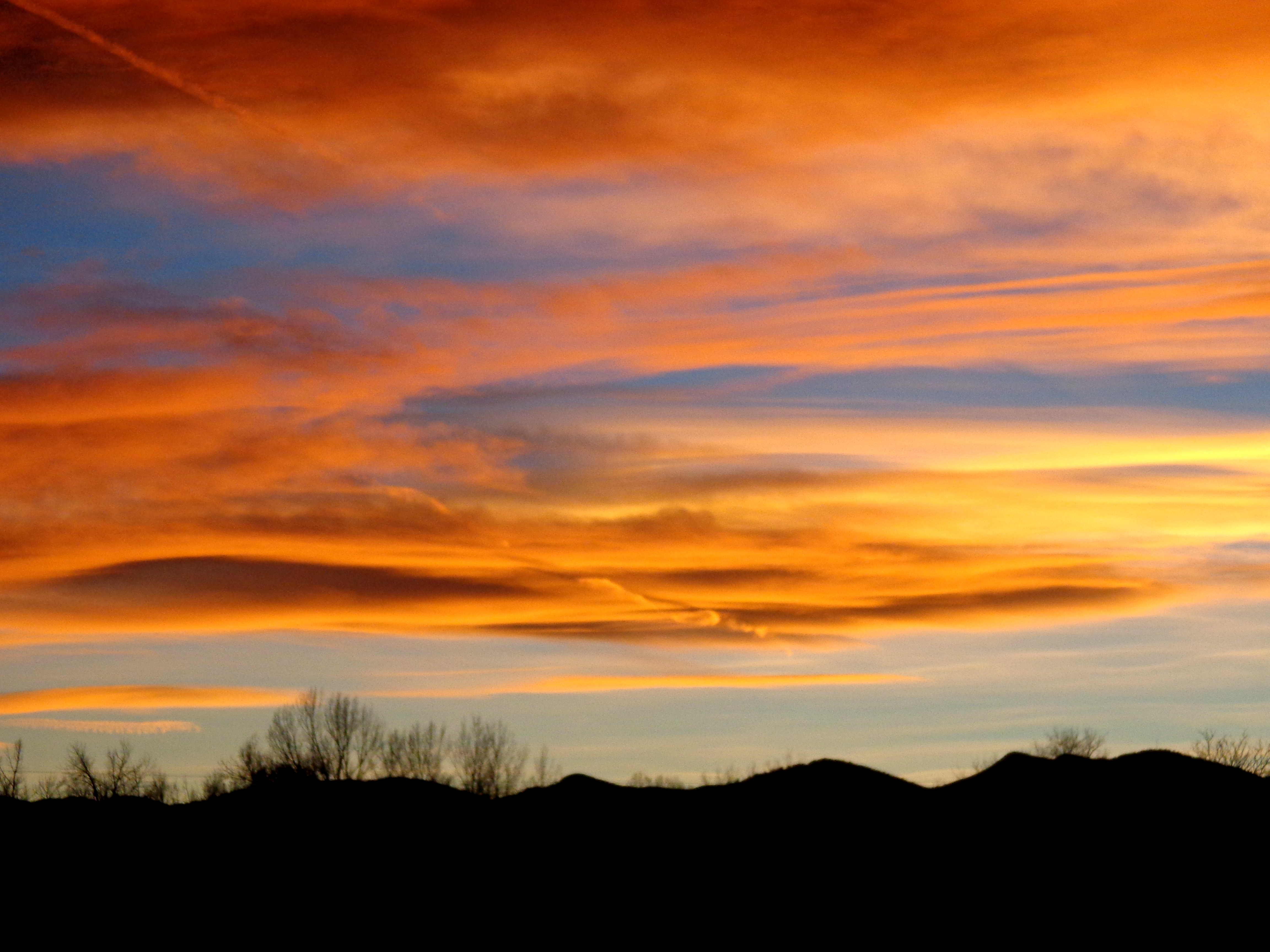 Orange And Blue Sunset Over Rolling Hills Picture Free