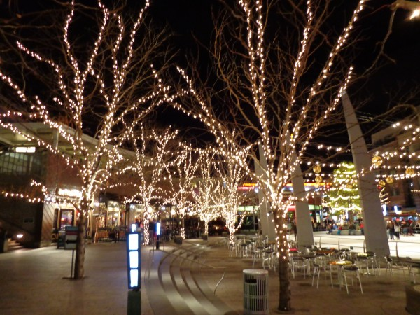 Outdoor Plaza Nighttime Scene with Skating Rink and Christmas Lights - Free High Resolution Photo