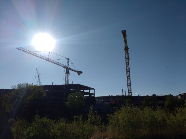 Blue Sky with Construction Cranes and Sun - Free High Resolution Photo