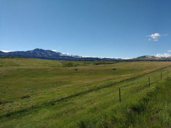 Green Field with Mountains in the Distance - Free High Resolution Photo